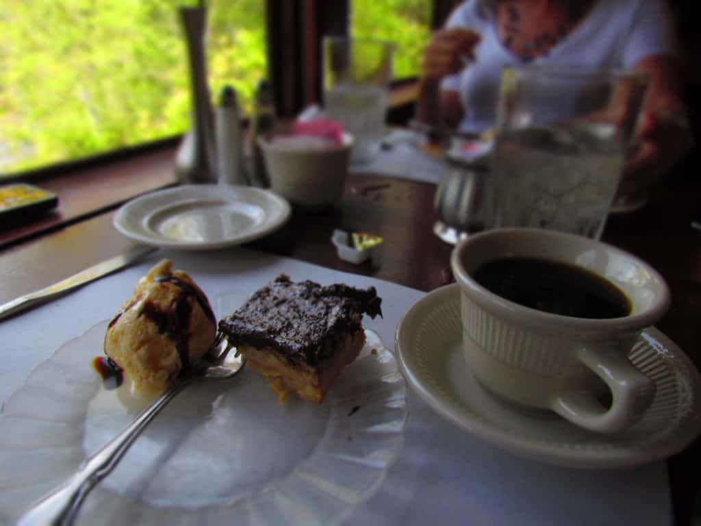 A sweet treat of cake and ice cream goes well with fresh coffee.