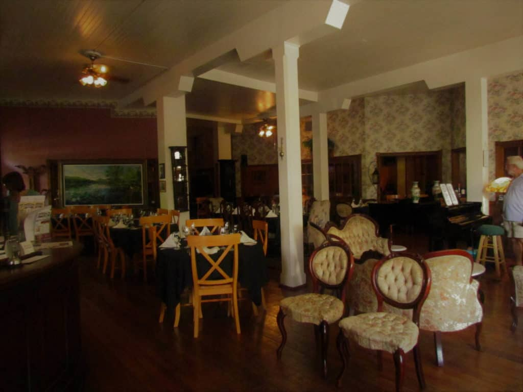 The dining area of the Grand Taverne Restaurant is decorated in Victorian fashion.