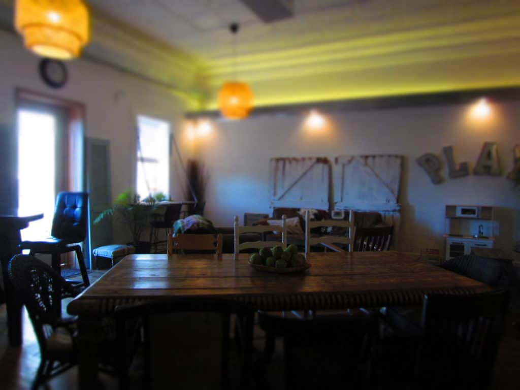A farmhouse table offers ample seating for a crowd at Third Space Coffee.