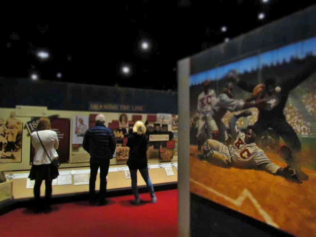 Visitors examine displays about the history of the Negro Leagues baseball Museum.