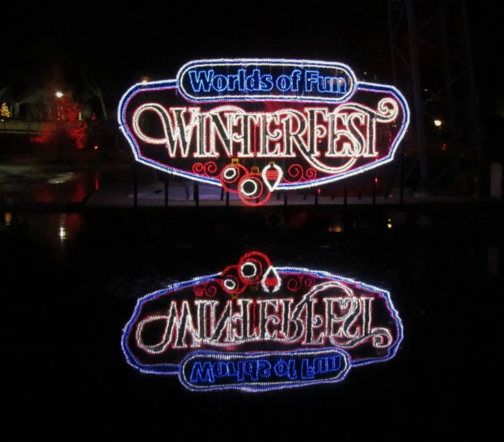 The Winterfest logo is reflected in the the calm waters of a late fall night.