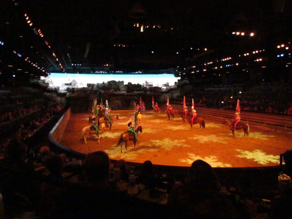 Riders parade around the arena at during various events at Dixie Stampede.