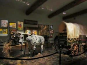 A display at the museum offers guests a view of a wagon used to cross the plains.