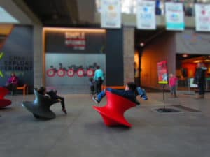 Spinning chairs shaped like tops are favorites of the kids.