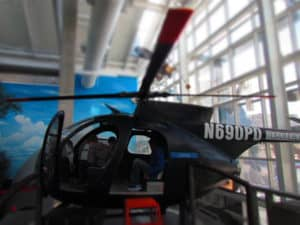 Kids enjoy playing in the helicopter at Science City.