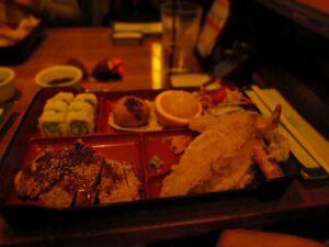 Chicken teriyaki, sushi, tempura veggies, and other dishes make up a bento box option.