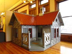 A Victorian style playhouse is available for children to play in at the Watkins Museum.