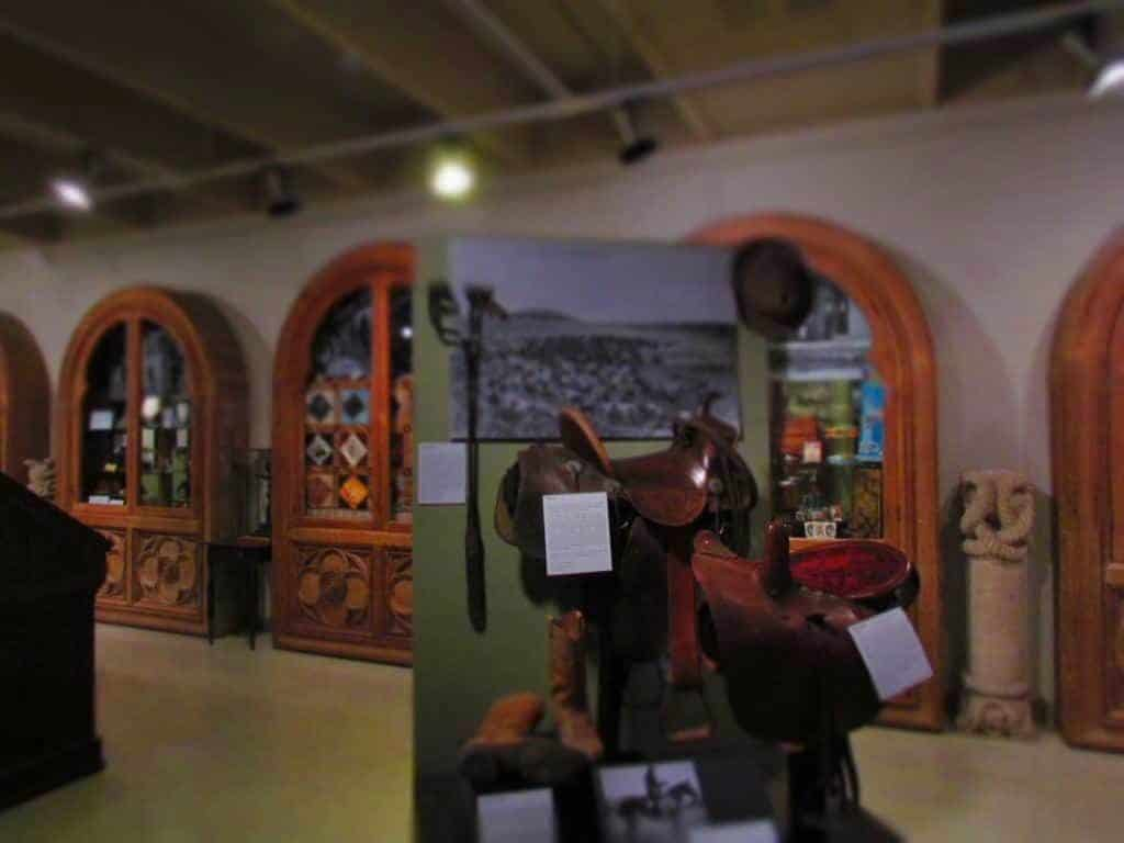 A saddle and boots are a reminder of Riley County's ties to the cowboys who moved cattle across the Flint Hills.