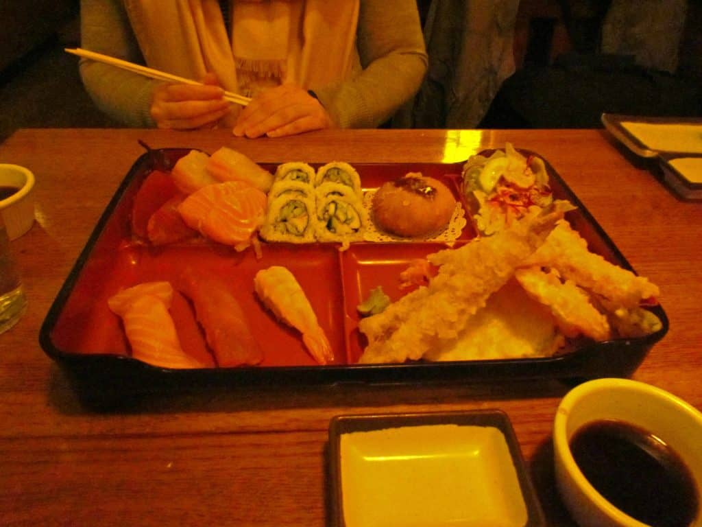A sushi bento box offers plenty of fresh fish along with other delectable dishes.