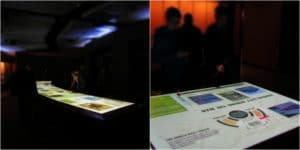An over-sized table holds interactive exhibits for visitors to discover.