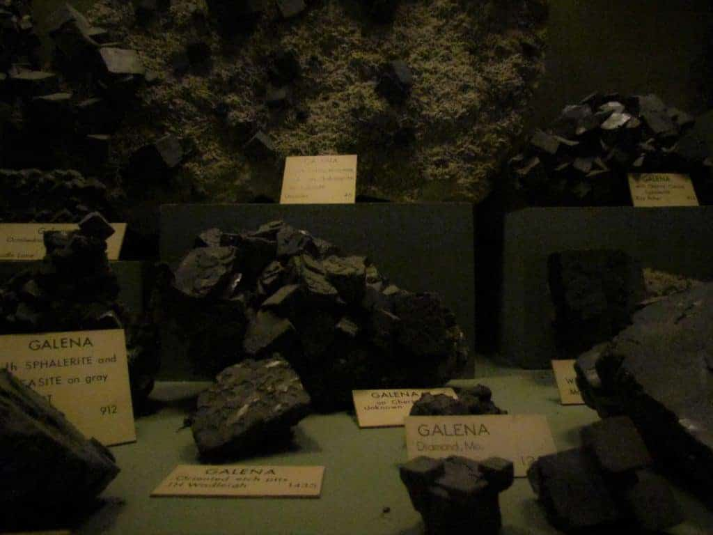 A display of Galena samples show the variety of ways this mineral is found.