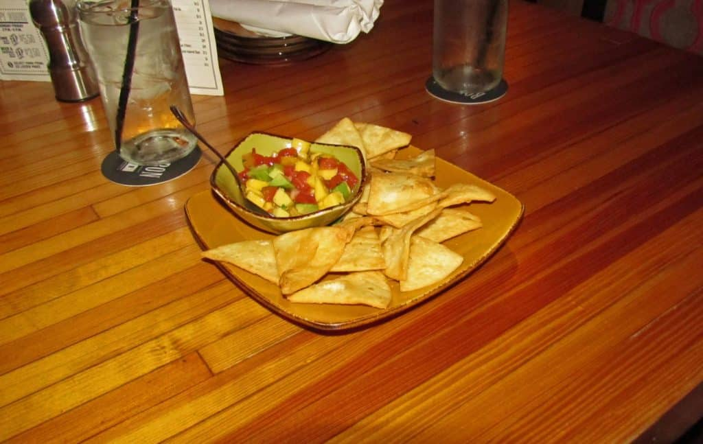 A sweet and tangy ceviche is paired with crispy tortilla chips.