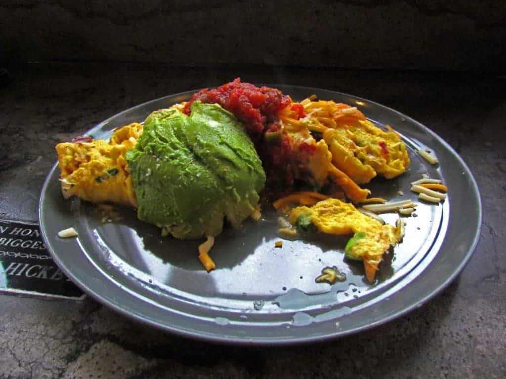 The Migas is a dish featuring scrambled eggs with an assortment of add-ons.