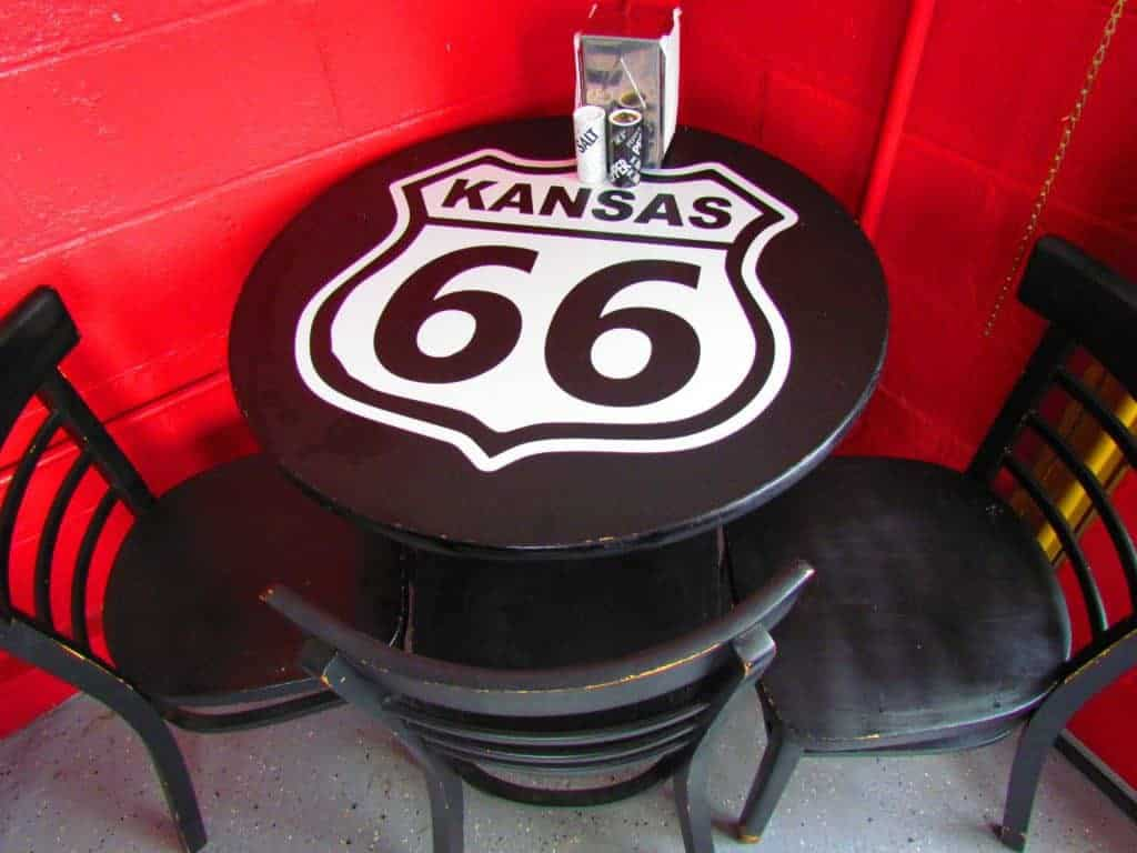 A tabletop is decorated with the familiar Route 66 highway shield.