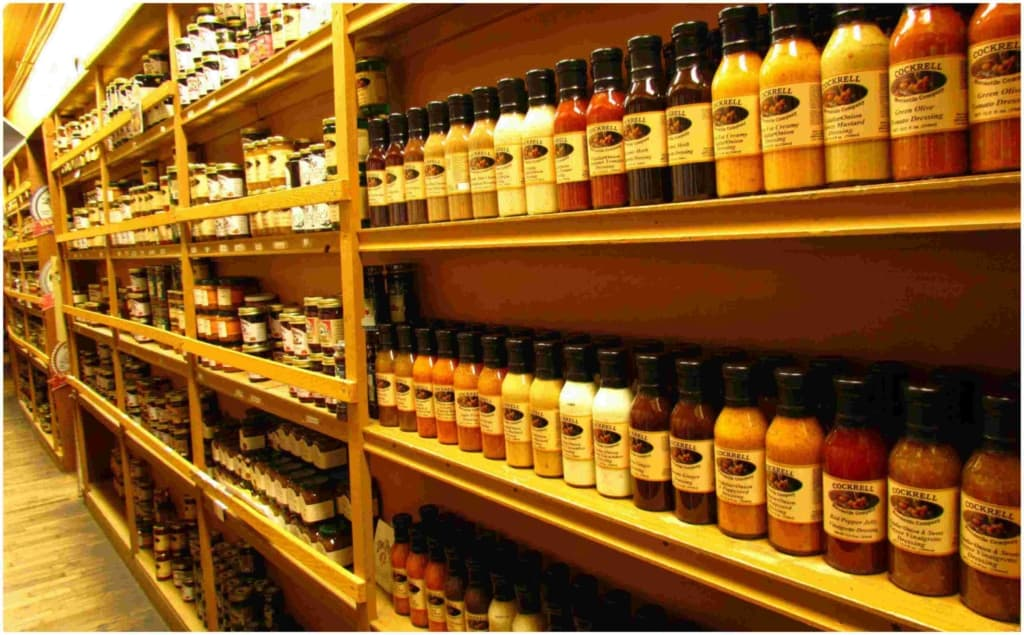 An aisle is filled from floor to ceiling with all types of sauces and mixes.