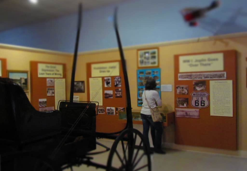 Crystal examines the historical displays at the Joplin Museum Complex.