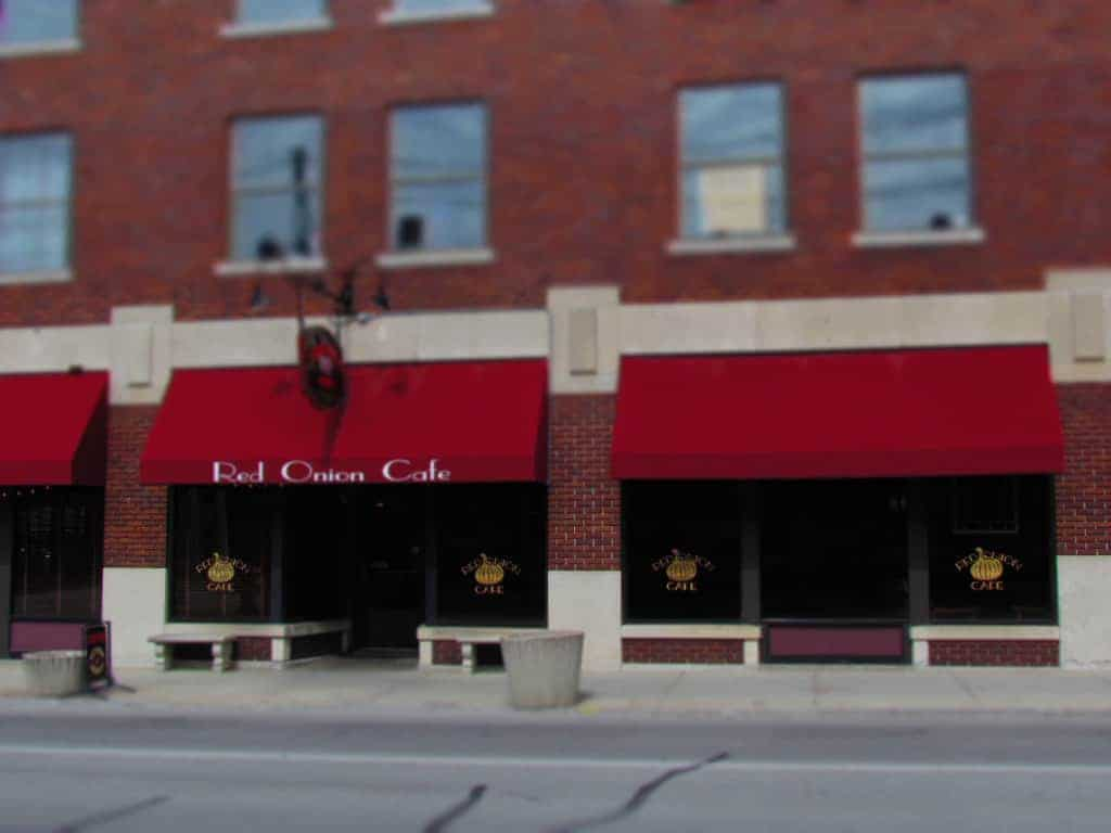 The exterior of the Red Onion Cafe is easily recognized by the colorful awnings.