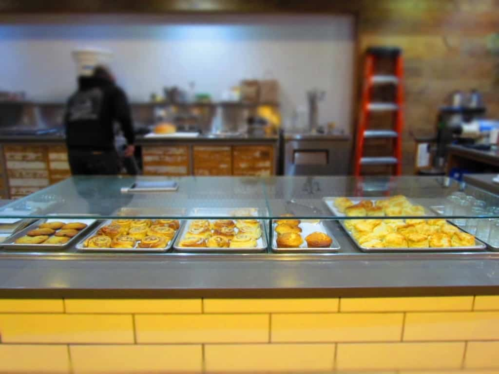 A variety of baked goods are displayed for customers.