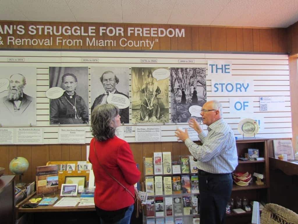 Jim, a staff member at Miami County Historical Museum, explains the timeline to one of the authors.