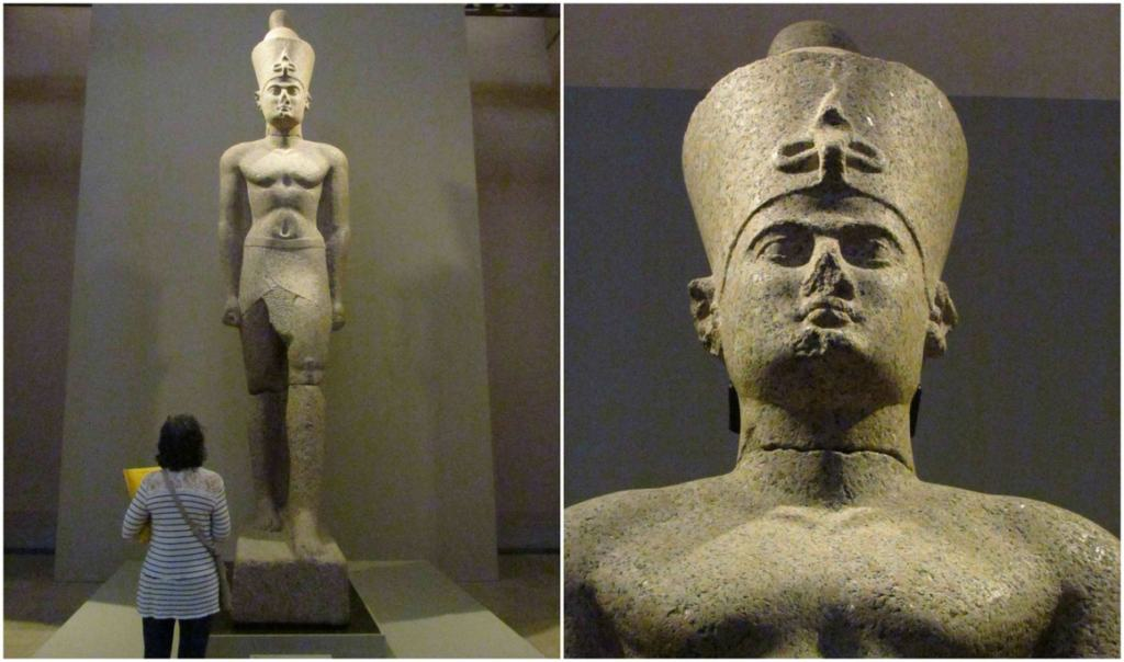 A sixteen foot tall statue of an Egyptian pharaoh stands guard in one of the museum galleries.
