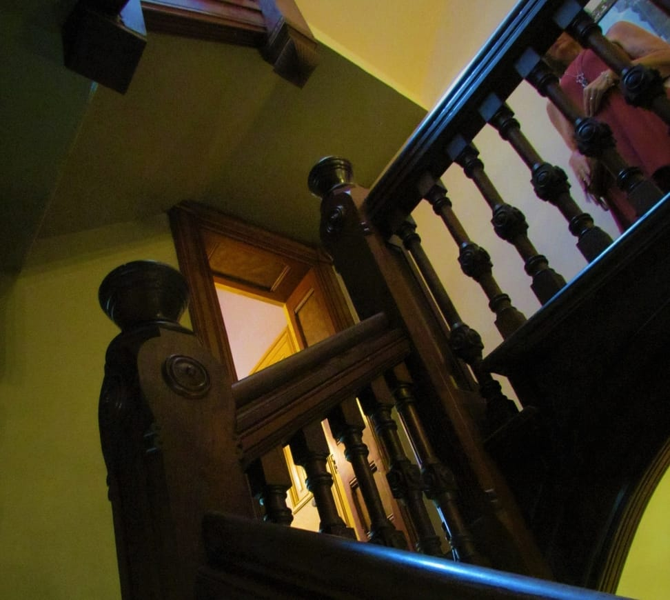 An intricately decorated staircase leads to the second floor bedrooms.
