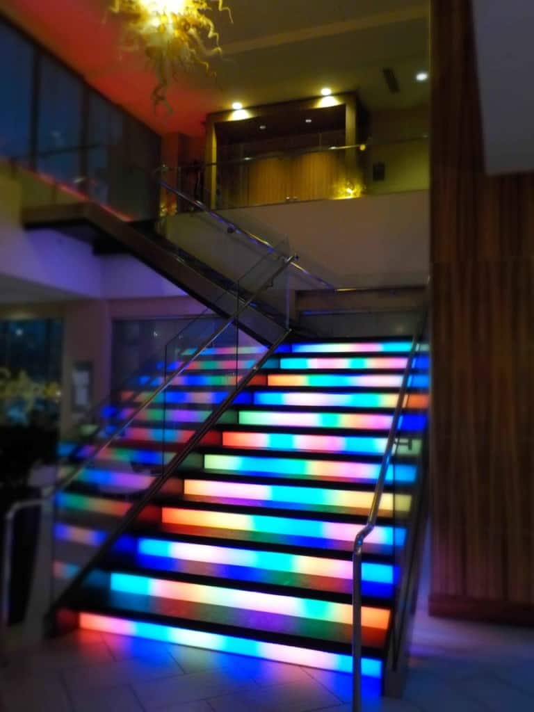 The lobby staircase features lights that change in an inviting pattern.