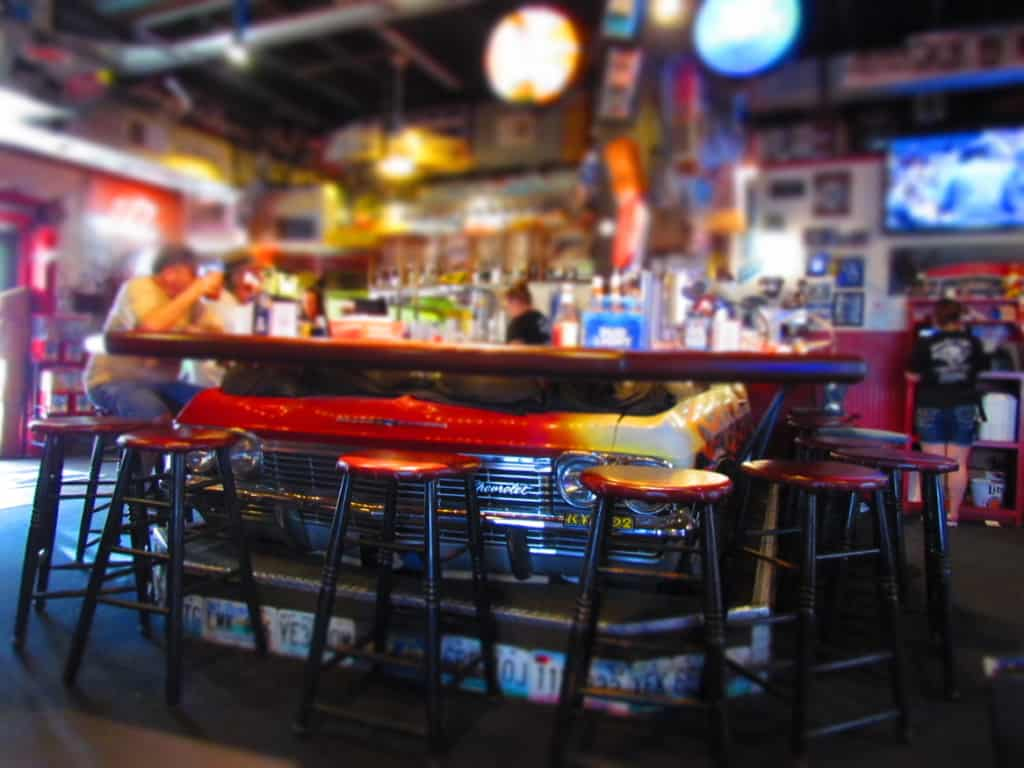 The car theme is evident in the bar area where an actual car front end is used for decor.