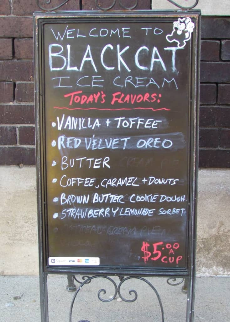 A billboard outside of the shop shows the available flavors for the day.