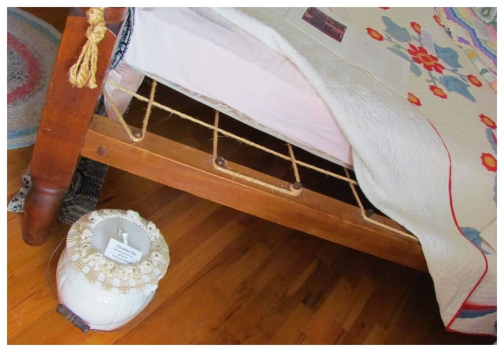 A period bed shows the need for ropes to support the mattress.
