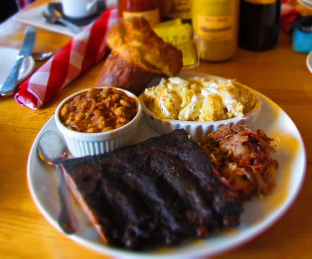 A two meat platter comes with two side choices as well as a popover.