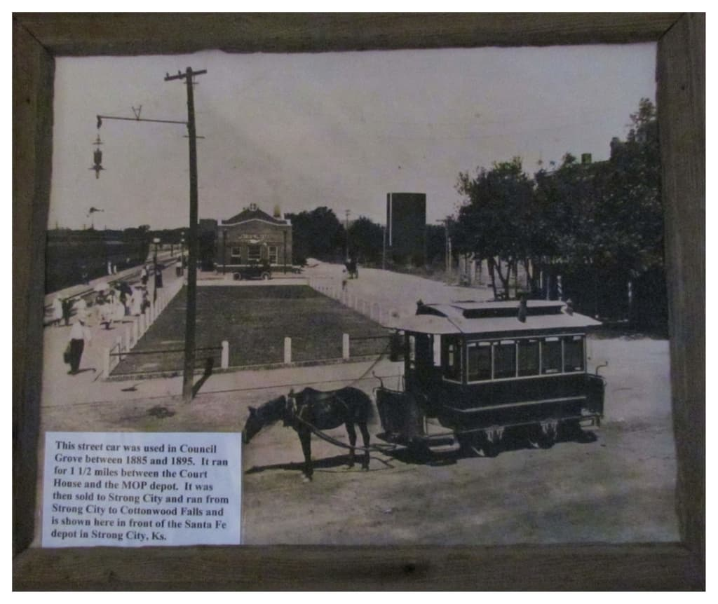 A picture shows an old streetcar that once ran the main street in Council Grove.