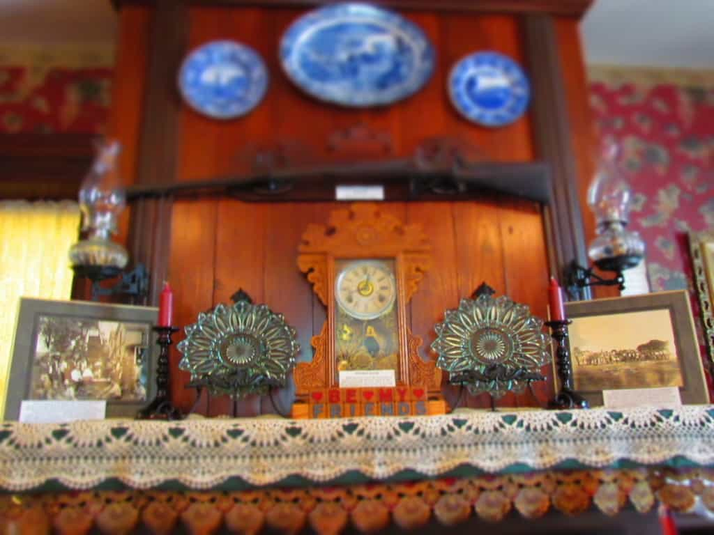 A mantle holds period pieces from the 1800's at Trail Days Cafe in Council Grove, Kansas.