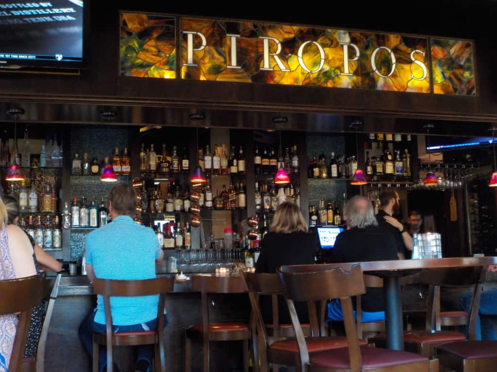 The bar area at Piropo's offers a variety of seating options.