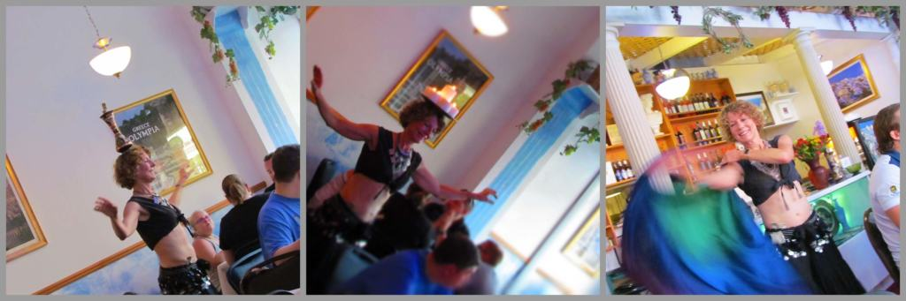 A local belly dancer entertains the crowd of diners.