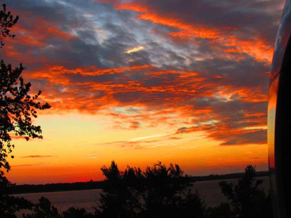 A Kansas sunset lights up the sky near Council Grove.