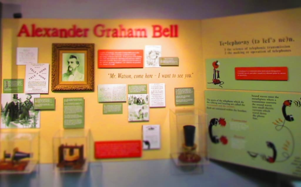 A display on Alexander Graham Bell shows the importance of his most popular invention.
