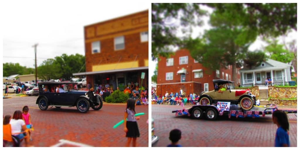 Antique cars are seen at the parade.