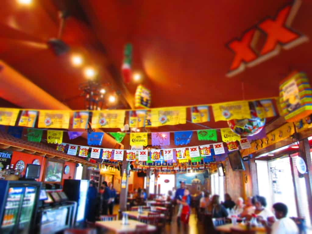 The interior of Taqueria Mexico is bright and happy.