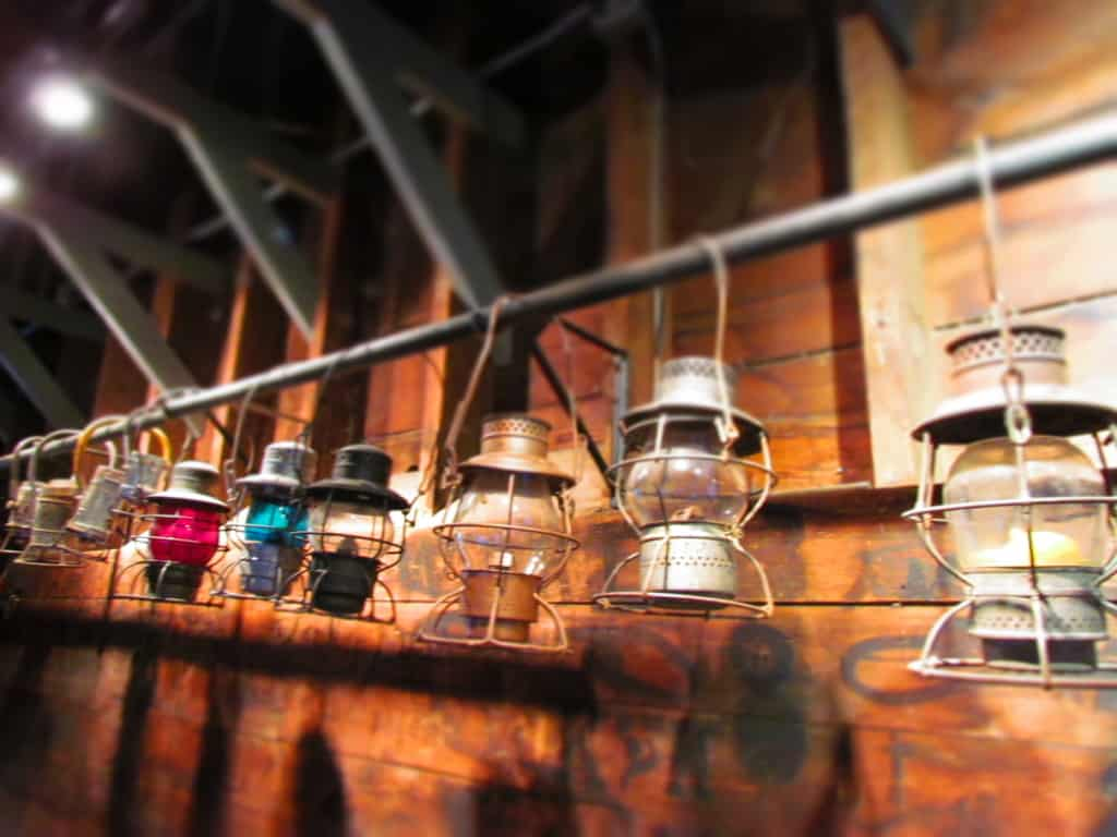 An assortment of lanterns make a pleasant presentation hanging all in a row.