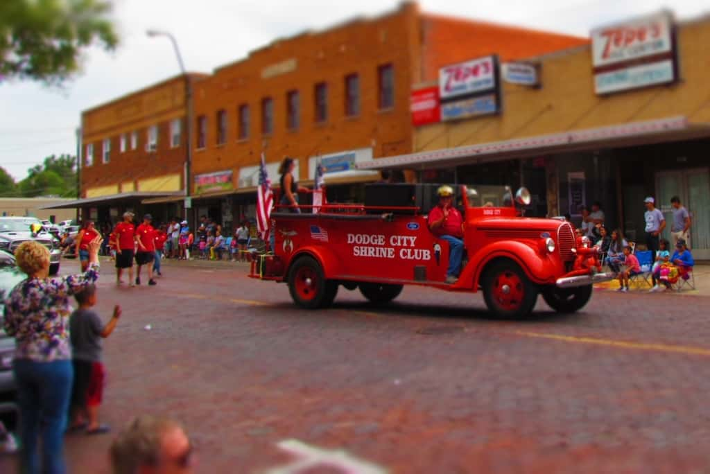 The Dodge City Shriners participate in an old fire engine.