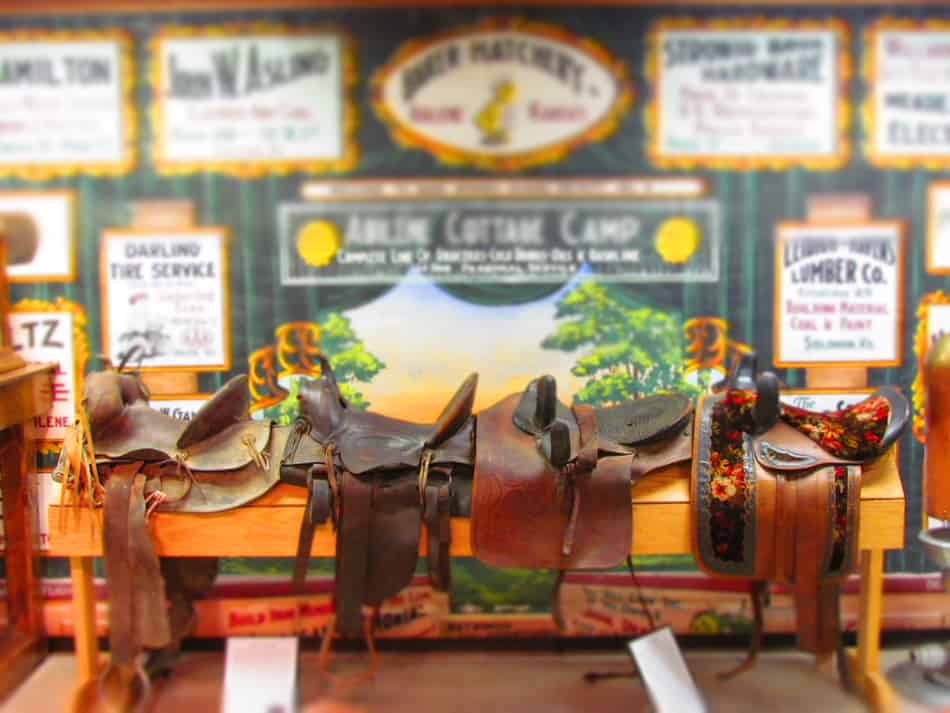 An assortment of saddles show the variety that was available for cowboys.