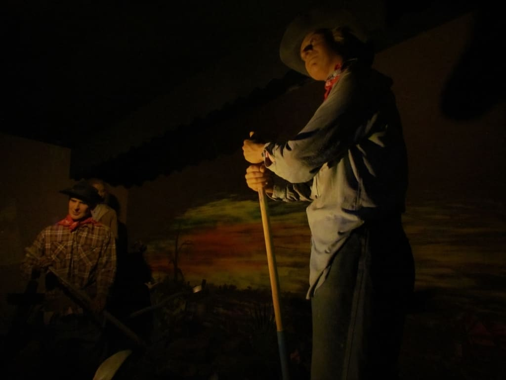 Gravediggers do their duty in a recreation of the Boot Hill Cemetery.