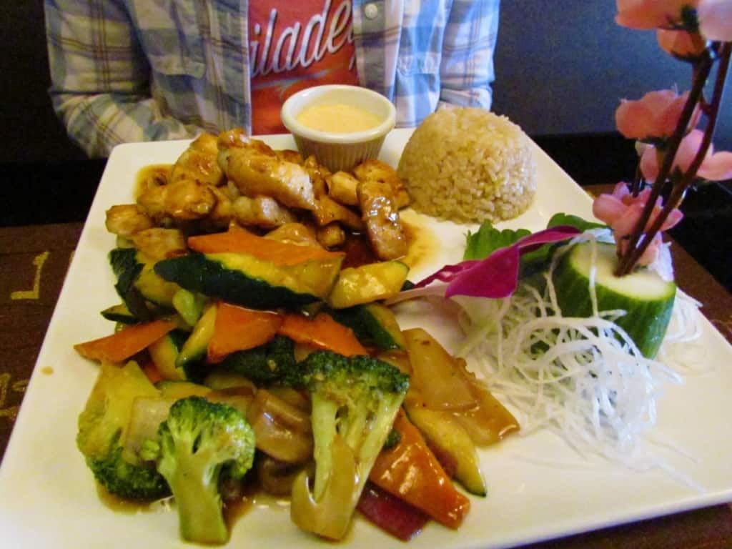 The Hibachi Chicken is a plate full of food.