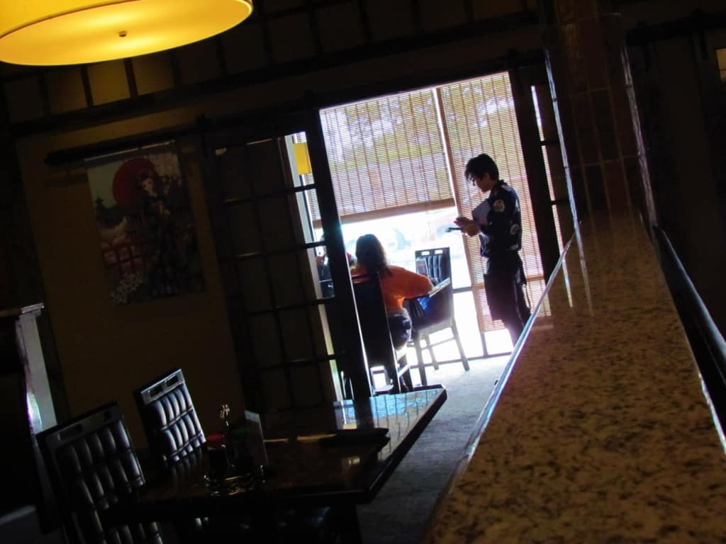 A server takes the order from customers at Oishi Japanese Cuisine.