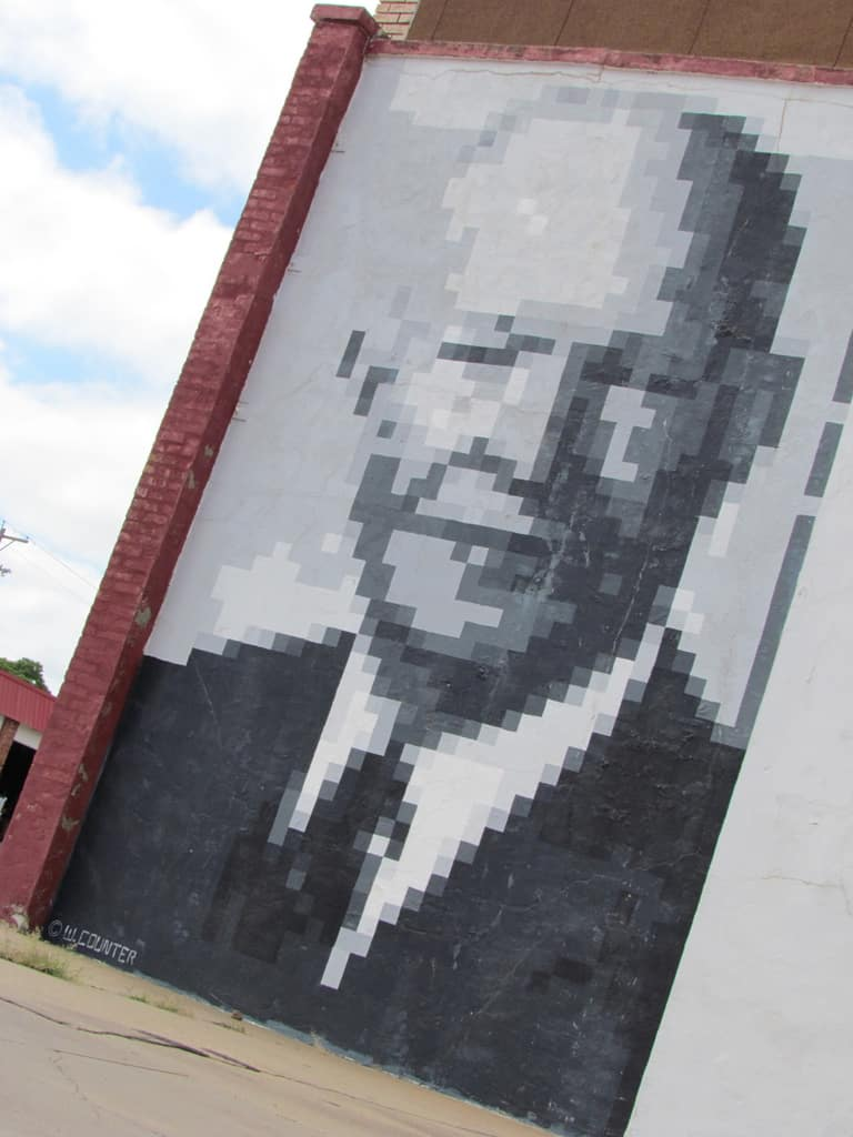 A pixelated photo of Ike comes into focus at a distance.