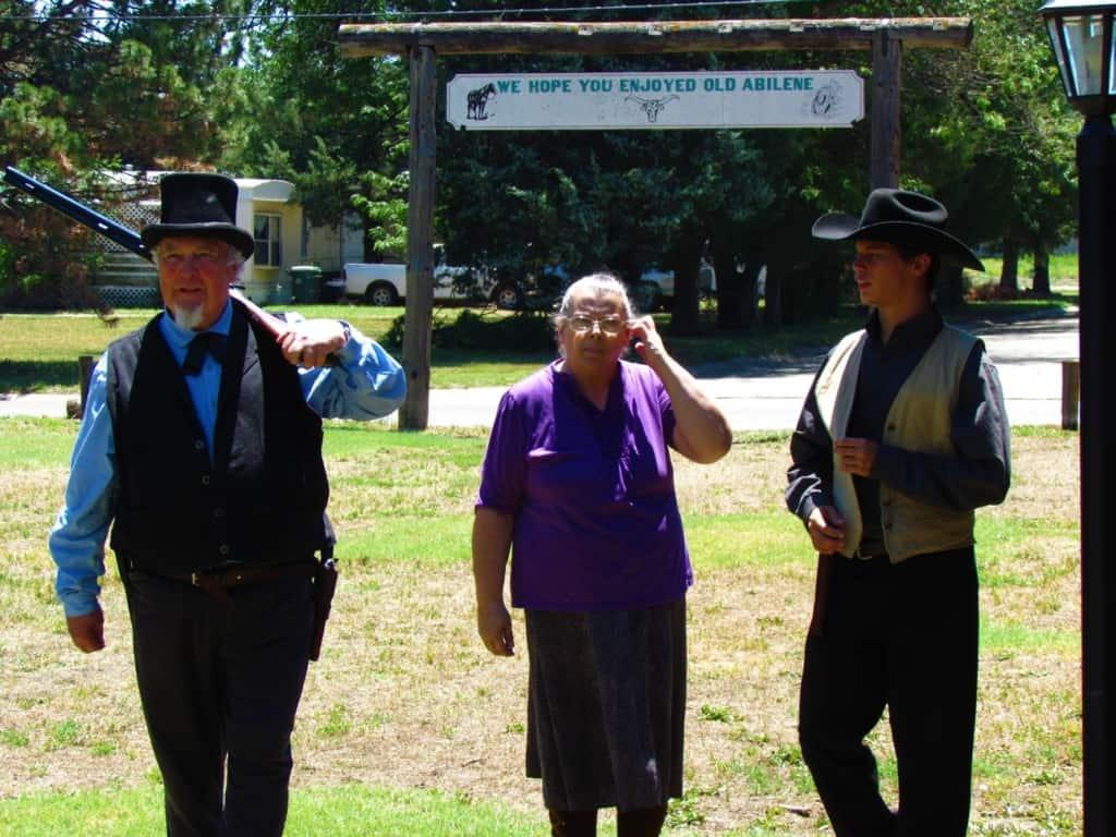 A group of actors thank the crowd for visiting Old Abilene Town.