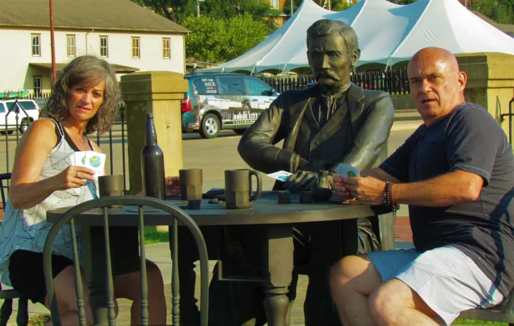 The authors pose with a statue of Doc Holiday at the Boot Hill Museum in Dodge City, Kansas.
