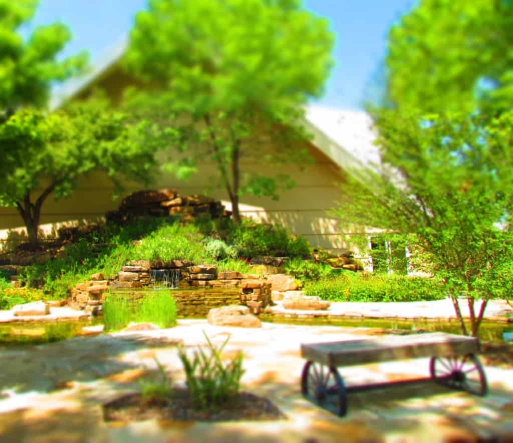 A secluded garden offers guests a quiet spot to reflect.