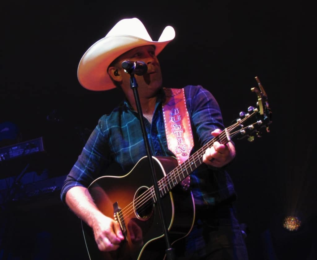 Justin Moore entertains the crowd during a Dodge City Days event.