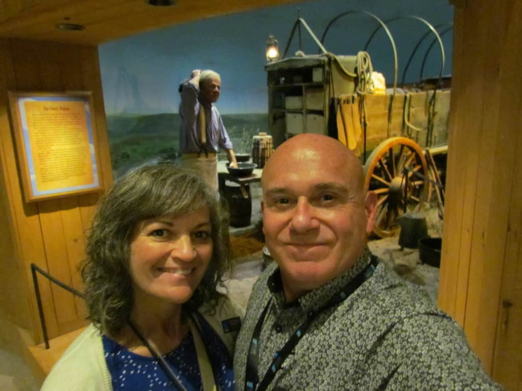 The authors pose for a selfie in front of a display at the National Cowboy & Western Heritage Museum in Oklahoma City.